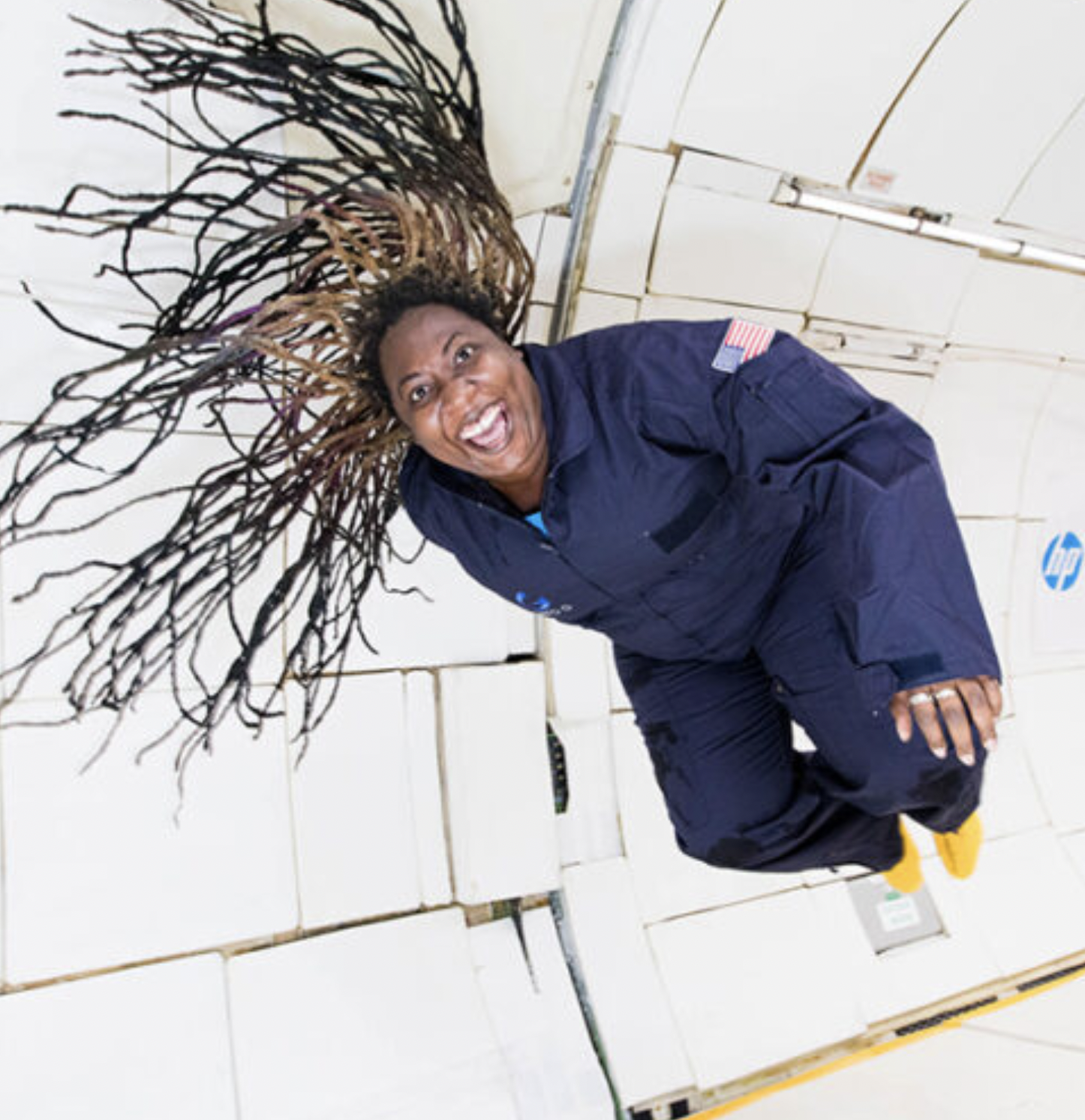 Smiling woman with long hair floating during a ZERO-G flight. Credit: ZERO-G