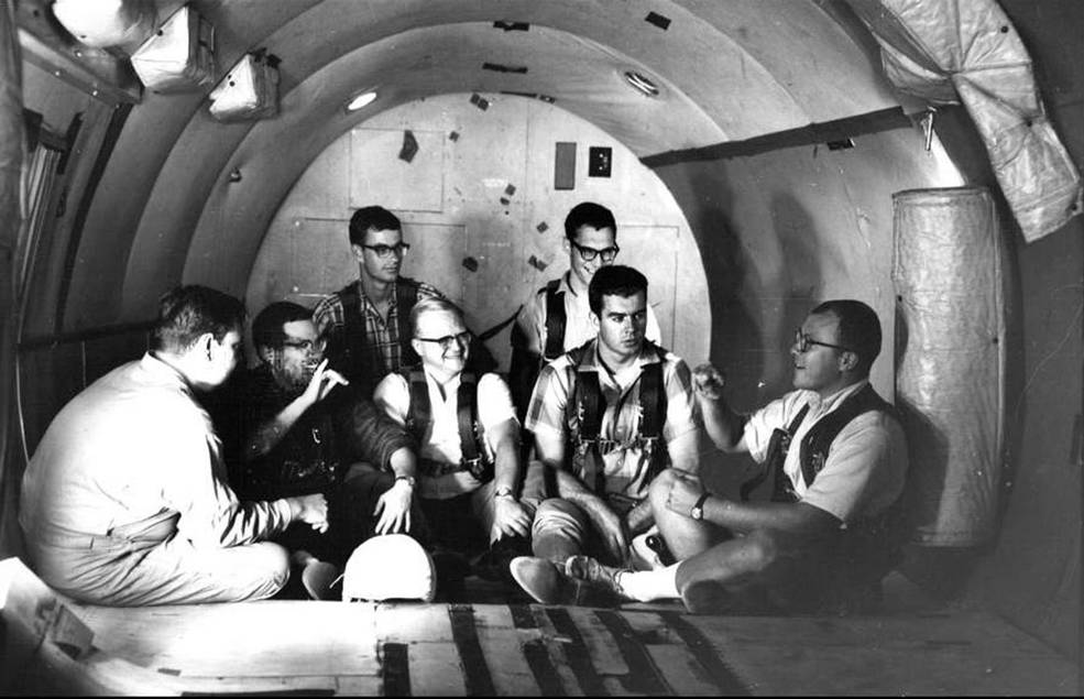 NASA Gallaudet research participants chat in sign language while sitting in a zero gravity aircraft before take-off. credit: U.S. Navy/Gallaudet University collection.